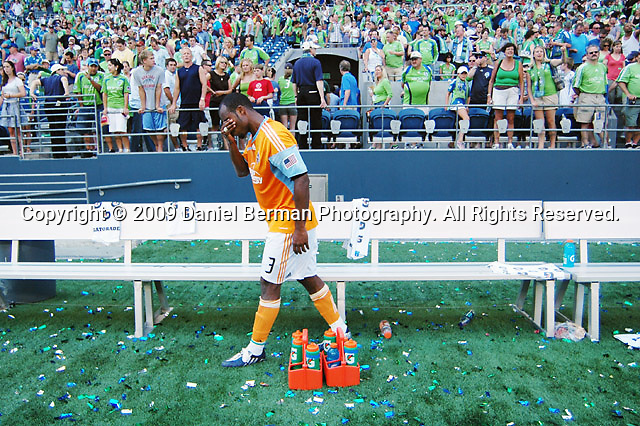 The Houston Dynamo's Julius James puts his hand over his face following the teams 2-1 loss to the Seattle Sounders Saturday July 11, 2009 at Qwest Field. Photo by Daniel Berman/SeattlePI.com