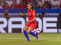 LYON,  - JULY 2: Christen Press #23 crosses the ball during a game between England and USWNT at Stade de Lyon on July 2, 2019 in Lyon, France.
