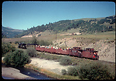 RGS #74 with RMRRC excursion near San Miguel.  Consist is cabooses #0400 and #0401, three gondolas and business car B-20 &quot;Edna&quot;.<br /> RGS  San Miguel, CO  Taken by Kindig, Richard H. - 9/2/1951