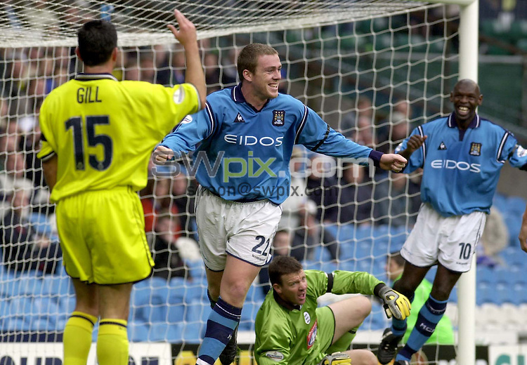 Pix: Ben Duffy....Manchester City v Birmingham City-Nationwide First Division Football....15/09/2001..COPYWRIGHT PICTURE>>SIMON WILKINSON>>01943 436649>>..Manchester's Richard Dunne wheels away after scoring his teams second goal
