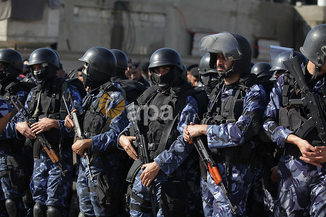 Palestinian police forces stand ready during preparations to mark the anniversary of former Palestinian interior minister Said Siam's, in Gaza City on January 11, 2013. Photo by Ashraf Amra