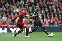 Manchester City's Fernandinho under pressure from Liverpool's Jordan Henderson<br /> <br /> Photographer Rich Linley/CameraSport<br /> <br /> The Premier League - Liverpool v Manchester City - Sunday 7th October 2018 - Anfield - Liverpool<br /> <br /> World Copyright &copy; 2018 CameraSport. All rights reserved. 43 Linden Ave. Countesthorpe. Leicester. England. LE8 5PG - Tel: +44 (0) 116 277 4147 - admin@camerasport.com - www.camerasport.com