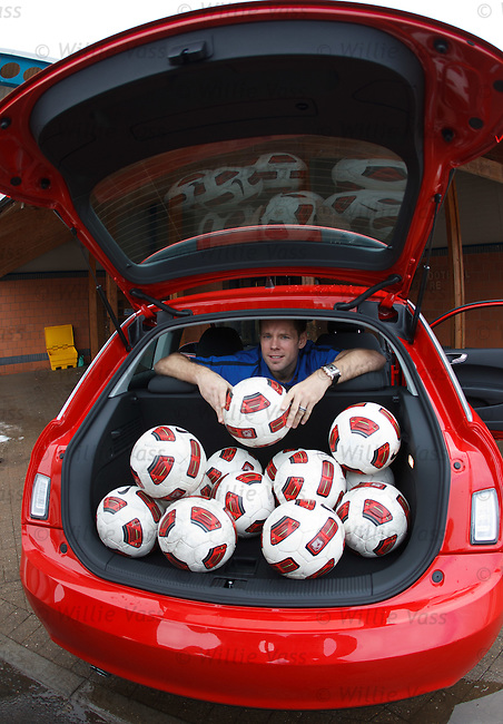 James Beattie in the back of a new Audi A1 as fans can win the car if they can kick a ball in to the boot from the half way line