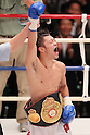 (L to R) Akira Yaegashi (JPN), Pornsawan Porpramook (THA), October 24, 2011 - Boxing : Akira Yaegashi of Japan celebrates after wining during the WBA Minimum weight title bout at Korakuen, Tokyo, Japan. Akira Yaegashi won by TKO after the fight was stopped in the tenth round. (Photo by Yusuke Nakanishi/AFLO SPORT) [1090].