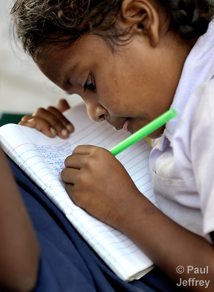A girl studies in an after school tutoring program in Poonthandalam, a village in the southern India state of Tamil Nadu.