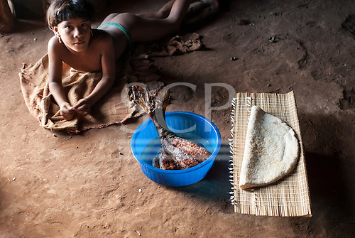 Xingu Indigenous Park, Mato Grosso State, Brazil. Aldeia Matipu. Kaitama with beju and fish for our dinner.