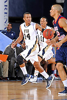 25 February 2012:  FIU guard DeJuan Wright (14) breaks for the basket in the second half as the FIU Golden Panthers defeated the University of South Alabama Jaguars, 81-74, at the U.S. Century Bank Arena in Miami, Florida.