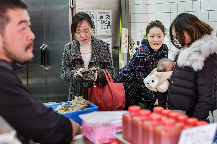 Osaka, Japan, November 25 2016 - In the shop of Pu Yon-gon, a boucher of Osaka&rsquo;s Korea town in Tsuruhashi, the home of the largest Korean community (Zainichi) in Japan.<br /> The majority of Koreans in Japan are Zainichi Koreans, often known simply as Zainichi , who are the permanent ethnic Korean residents of Japan. The term &quot;Zainichi Korean&quot; refers only to long-term Korean residents of Japan who trace their roots to Korea under Japanese rule, distinguishing them from the later wave of Korean migrants who came mostly in the 1980s. The estimated population is about 500,000 people. As of 2016, about 90% of them have South Korean nationality and 10% of them are considered by Japanese administration as &laquo;&nbsp;Korean&nbsp;&raquo; (chosenjin), the word used for korean people before the division between North and South Korea in 1948. The ratio used to be the opposite in the 1950ies.