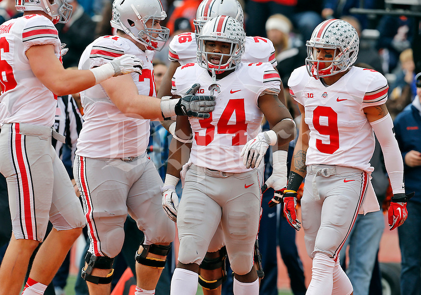 Ohio State Buckeyes running back Carlos Hyde (34) is congratulated for his touchdown in the third quarter of their game at Memorial Stadium in Champaign, Ill on November 16, 2013. (Columbus Dispatch photo by Brooke LaValley)