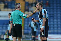 Wycombe Wanderers captain makes the case for the defence to referee Seb Stockbridge during the Sky Bet League 2 match between Mansfield Town and Wycombe Wanderers at the One Call Stadium, Mansfield, England on 31 October 2015. Photo by Garry Griffiths.