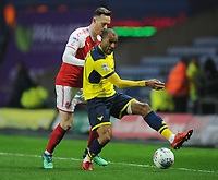 Oxford United's Wes Thomas under pressure from Fleetwood Town's Gethin Jones<br /> <br /> Photographer Kevin Barnes/CameraSport<br /> <br /> The EFL Sky Bet League One - Oxford United v Fleetwood Town - Tuesday 10th April 2018 - Kassam Stadium - Oxford<br /> <br /> World Copyright &copy; 2018 CameraSport. All rights reserved. 43 Linden Ave. Countesthorpe. Leicester. England. LE8 5PG - Tel: +44 (0) 116 277 4147 - admin@camerasport.com - www.camerasport.com