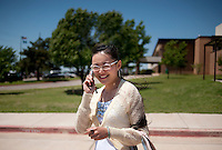 "Yue Zheng (cq), calls her mother after teaching class at Macarthur High School in Lawton, Oklahoma, April 29, 2010. Zheng is teaching in the US as part of a ""guest teacher"" program for two years and will soon be returning to her home in Henan province in China...PHOTO/ MATT NAGER"