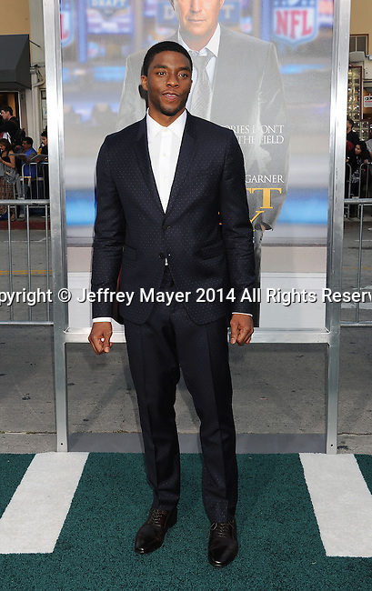 WESTWOOD, CA- APRIL 07: Actor Chadwick Boseman attends the Los Angeles premiere of 'Draft Day' at the Regency Village Theatre on April 7, 2014 in Westwood, California.