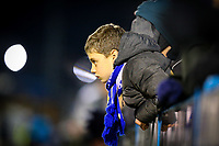 A young Guiseley fan watches on during the second half<br /> <br /> Photographer Alex Dodd/CameraSport<br /> <br /> The Emirates FA Cup Second Round - Guiseley v Fleetwood Town - Monday 3rd December 2018 - Nethermoor Park - Guiseley<br />  <br /> World Copyright © 2018 CameraSport. All rights reserved. 43 Linden Ave. Countesthorpe. Leicester. England. LE8 5PG - Tel: +44 (0) 116 277 4147 - admin@camerasport.com - www.camerasport.com