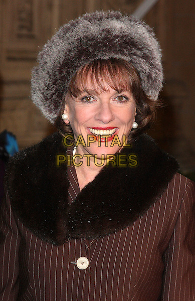 ESTHER RANTZEN .Attending the Gala VIP Opening Night of Cirque du Soleil's 'Varekai' at the Royal Albert Hall, London, England, UK, .January 5th 2010..arrivals portrait headshot smiling lipstick make-up pearl earrings brown pinstripe striped jacket  fur hat  collar .CAP/ROS.©Steve Ross/Capital Pictures.
