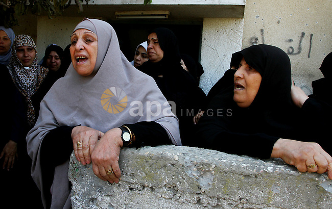 Palestinian relatives of Khaled Sha'at, a member of an armed Palestinian faction, and his two-year-old son Malek mourn during their funeral in Rafah in the southern Gaza Strip August 19, 2011. The Israeli air strike killed the leader of an armed Palestinian faction, a top lieutenant, three other members and Malek Sha'at in the southern Gaza Strip on Thursday, the group said, hours after Israel blamed gunmen from the territory for cross-border attacks. Photo by Ashraf Amra