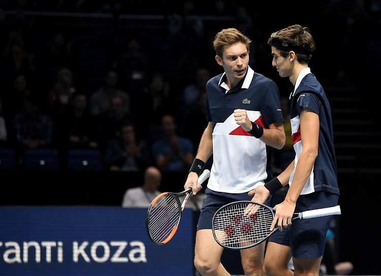 Pierre-Hugues Herbert and Nicolas Mahut  in action against Oliver Marach and Mate Pavic <br /> <br /> Photographer Hannah Fountain/CameraSport<br /> <br /> International Tennis - Nitto ATP World Tour Finals Day 2 - O2 Arena - London - Monday 12th November 2018<br /> <br /> World Copyright © 2018 CameraSport. All rights reserved. 43 Linden Ave. Countesthorpe. Leicester. England. LE8 5PG - Tel: +44 (0) 116 277 4147 - admin@camerasport.com - www.camerasport.com