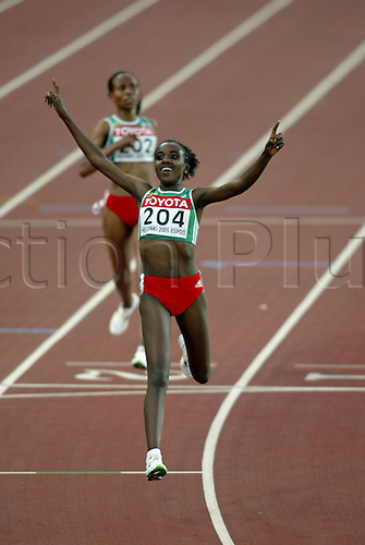 13 August 2005: No 204. Ethiopian athlete Tirunesh Dibaba (ETH) wins the Women's 5000m Final at the IAAF World Athletics Championships, held in the Olympic Stadium, Helsinki, Finland Photo: Glyn Kirk/actionplus...050813 running distance runner woman women athlete female celebration celebrates winner