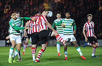 Lincoln City's Matt Rhead gets his head to the ball under pressure from Yeovil Town's Courtney Duffus<br /> <br /> Photographer Andrew Vaughan/CameraSport<br /> <br /> The EFL Sky Bet League Two - Lincoln City v Yeovil Town - Friday 8th March 2019 - Sincil Bank - Lincoln<br /> <br /> World Copyright © 2019 CameraSport. All rights reserved. 43 Linden Ave. Countesthorpe. Leicester. England. LE8 5PG - Tel: +44 (0) 116 277 4147 - admin@camerasport.com - www.camerasport.com