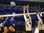 Marymount's Emileigh Rettig hits against St. Mary's during a college volleyball game in Lexington Park, MD, on Wednesday, Oct. 29, 2014. Marymount won 3-2 to go 24-9 on the season.<br /> Photo by Cathleen Allison
