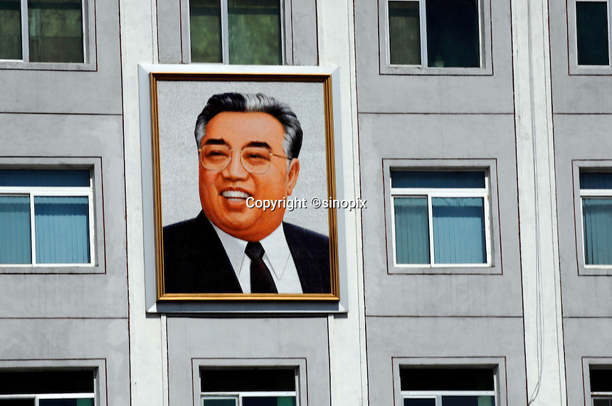 "Propoganda poster of Kim ll-sung on a factory in Pyongyang, North Korea. The DPRK (Democratic People's Republic of Korea) is the last great dictatorship where the people are bombarded with images of the ""Eternal President"" Kim Il-sung who died in 1994 and his son and current leader Kim Jong-il who are worshipped like a God."