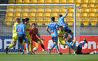 Players collide in the penalty box as Sydney's equaliser goes in during the A-League football match between Wellington Phoenix and Sydney FC at Sky Stadium in Wellington, New Zealand on Saturday, 21 December 2019. Photo: Dave Lintott / lintottphoto.co.nz