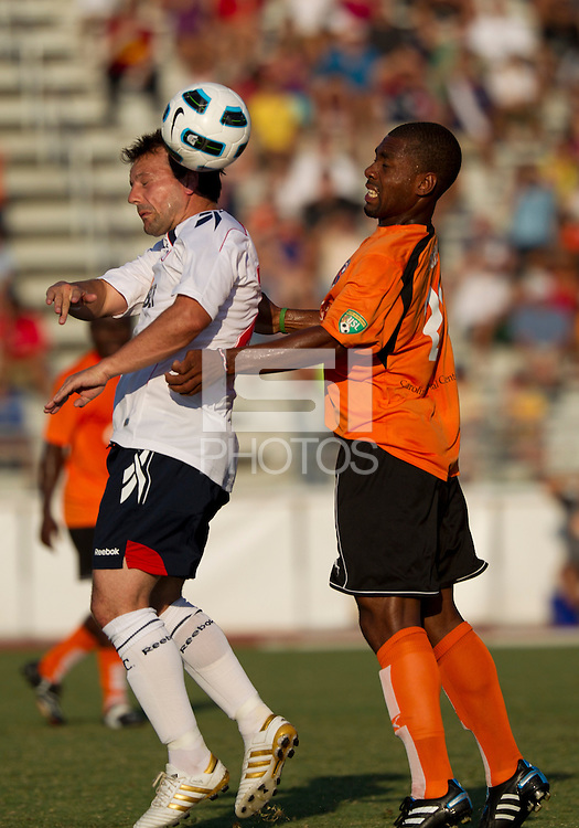 Robbie Blake (BW) heads the ball against Darren Toby (CE).  The Charlotte Eagles currently in 3rd place in the USL second division played a friendly against the Bolton Wanderers from the English Premier League losing 3-0.
