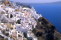 The beauty of Greece  Santorini Greece on top of the cliffs and the white beautiful buildings on the cliffs