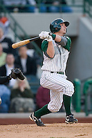 Drew Cumberland #3 of the Fort Wayne Tin Caps follows through on his swing versus the Dayton Dragons at Parkview Field April 16, 2009 in Fort Wayne, Indiana. (Photo by Brian Westerholt / Four Seam Images)