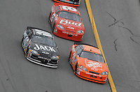 Feb 15, 2007; Daytona, FL, USA; Nascar Nextel Cup Series driver Tony Stewart (20) leads Clint Bowyer (07) and Dale Earnhardt Jr (8) during race one of the Gatorade Duel at Daytona International Speedway. Mandatory Credit: Mark J. Rebilas