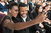 Lupita Nyong'o and Winston Dukeat at the 90th Oscars&reg; at the Dolby&reg; Theatre in Hollywood, CA on Sunday, March 4, 2018.<br /> *Editorial Use Only*<br /> CAP/PLF/AMPAS<br /> Supplied by Capital Pictures