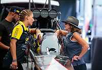 Jul 22, 2018; Morrison, CO, USA; NHRA top fuel driver Leah Pritchett (left) talks with Kay Torrence during qualifying for the Mile High Nationals at Bandimere Speedway. Mandatory Credit: Mark J. Rebilas-USA TODAY Sports