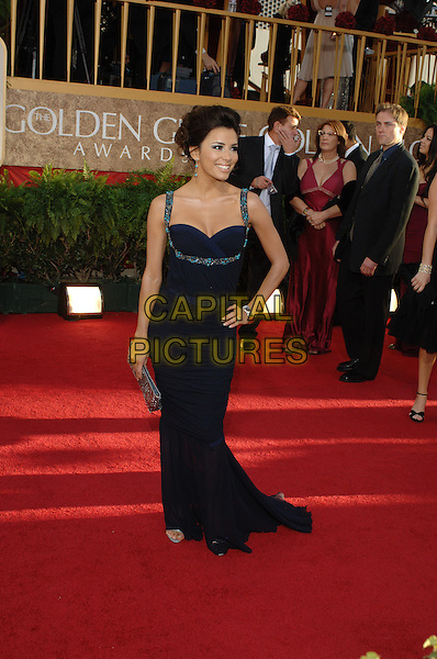 "EVA LONGORIA.Red Carpet Arrivals - 64th Annual Golden Globe Awards, Beverly Hills HIlton, Beverly Hills, California, USA..January 15th 2007.globes full length black navy blue dress hand on hip turquoise beads beaded hand on hip.CAP/AW.Please use accompanying story.Supplied by Capital Pictures.© HFPA"" and ""64th Golden Globe Awards"""