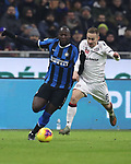Romelu Lukaku of Inter and Marko Rog of Cagliari go shoulder to shoulder during the Coppa Italia match at Giuseppe Meazza, Milan. Picture date: 14th January 2020. Picture credit should read: Jonathan Moscrop/Sportimage