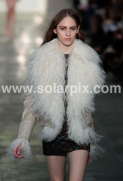 **ALL ROUND PICTURES FROM SOLARPIX.COM** **NO UK NEWSPAPER PUBLICATION**.**UK MAGAZINE & SUPPLEMENT PUBLICATION ONLY** AND NO PUBLICATION IN AUSTRALIA, BELGIUM, FRANCE, GERMANY, ITALY, SCANDINAVIA AND USA** Caption: The Fashion East catwalk show at London Fashion Week, London, UK. 22 February 2011 This pic: Fashion East catwalk show JOB REF: 12882 SFE DATE: 22_02_2011 **MUST CREDIT SOLARPIX.COM OR DOUBLE FEE WILL BE CHARGED** **MUST AGREE FEE BEFORE ONLINE USAGE** **CALL US ON: +34 952 811 768 or LOW RATE FROM UK 0844 617 7637**