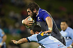 Sam Whitelock fends off Sam Nock. The game of Three Halves, a pre-season warm-up game between the Counties Manukau Steelers, Northland and the All Blacks, played at ECOLight Stadium, Pukekohe, on Friday August 12th 2016. Photo by Richard Spranger.