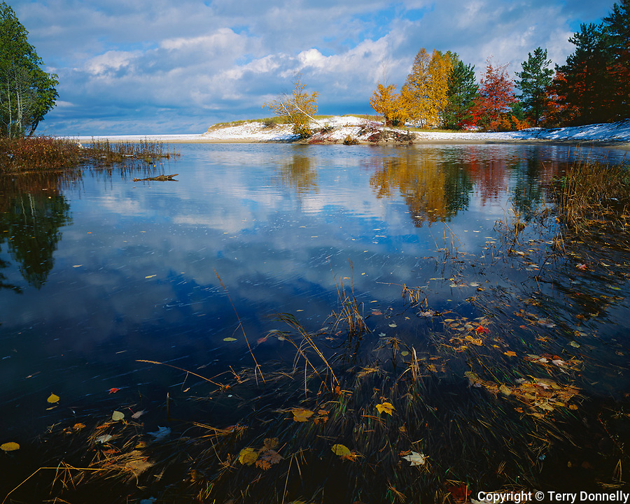 Pictured Rocks National Lakeshore, MI<br /> Fall colored trees and snow dusted dunes at the mouth of the Miner's River