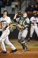 Siena Saints catcher Phil Madonna (3) looks for a popup off the bat of Brennan Bozeman (21)during a game against the UCF Knights on February 17, 2017 at UCF Baseball Complex in Orlando, Florida.  UCF defeated Siena 17-6.  (Mike Janes/Four Seam Images)