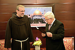 Palestinian President Mahmoud Abbas receives an invitation to attend Franciscan dinner, in the West Bank City of Ramallah, 18 December 2013. Photo by Thaer Ganaim