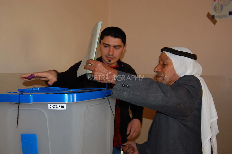 MOSUL, IRAQ: An elderly man casts his ballot in a polling station in Mosul...On March 7th, 2010, Iraq held nationwide parliamentary elections.