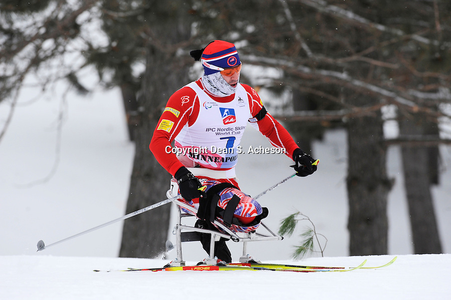 Jose Augusto Perez (42:29.5) crests a hill in the biathlon short distance race Saturday, Feb. 28, 2012 during the International Paralympics Committee (IPC) Nordic Skiing World Cup at Telemark Resort, Cable. Representing USA, Perez finished 18th in the Men 7.5KM LW 10-12 competition.