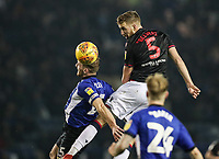 Bolton Wanderers' Mark Beevers heads at goal under pressure from Sheffield Wednesday's Tom Lees <br /> <br /> Photographer Andrew Kearns/CameraSport<br /> <br /> The EFL Sky Bet Championship - Sheffield Wednesday v Bolton Wanderers - Tuesday 27th November 2018 - Hillsborough - Sheffield<br /> <br /> World Copyright &copy; 2018 CameraSport. All rights reserved. 43 Linden Ave. Countesthorpe. Leicester. England. LE8 5PG - Tel: +44 (0) 116 277 4147 - admin@camerasport.com - www.camerasport.com