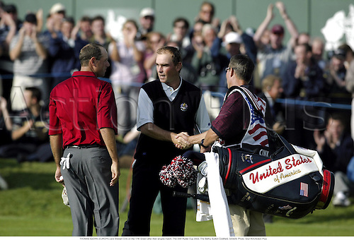 THOMAS BJORN (EUROPE) and Stewart Cink on the 17th Green after their singles match, The 34th Ryder Cup 2002, The Belfry, Sutton Coldfield, 020929. Photo: Glyn Kirk/Action Plus....golf golfer.shakes shaking hands....