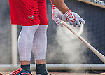 23 July 2016: Washington Nationals outfielder Bryce Harper applies tackifying spray on a new bat during batting practice prior to a game against the San Diego Padres at Nationals Park in Washington, DC. The Nationals defeated the Padres 3-2 on a Stephen Drew pinch-hit, walk-off triple in the bottom of the 9th inning to tie their series at one game apiece. Mandatory Credit: Ed Wolfstein Photo *** RAW (NEF) Image File Available ***