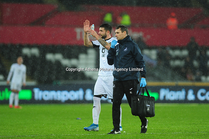 Borja Baston of Swansea City leaves the pitch injured during the Sky Bet Championship match between Swansea City and Charlton Athletic at the Liberty Stadium in Swansea, Wales, UK.  Thursday 02 January 2020