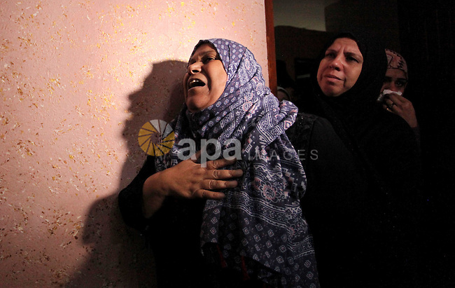 "Relatives of Mohammed Abu Saada, a 26-year-old Palestinian man who was reportedly killed in clashes with the Israeli army along the Gaza border, mourn during his funeral in the Nuseirat refugee camp in the central Gaza Strip on November 19, 2016. ""Mohammed Abu Saada died after being shot in the chest by Israeli soldiers in clashes east of the Al-Bureij camp,"" the health ministry in the Palestinian enclave on November 18. The Israeli army confirmed clashes in the area, which is in central Gaza, but could not immediately provide details. Photo by Ashraf Amra"