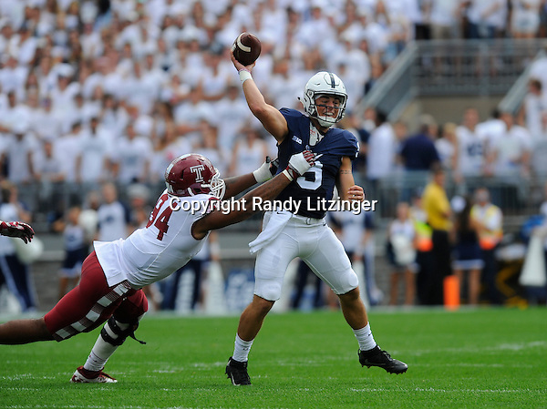 17 September 2016:  Penn State QB Trace McSorley (9) throws a pass while being pressured by Temple DE Jullian Taylor (94).The Penn State Nittany Lions defeated the Temple Owls 34-27 at Beaver Stadium in State College, PA. (Photo by Randy Litzinger/Icon Sportswire)
