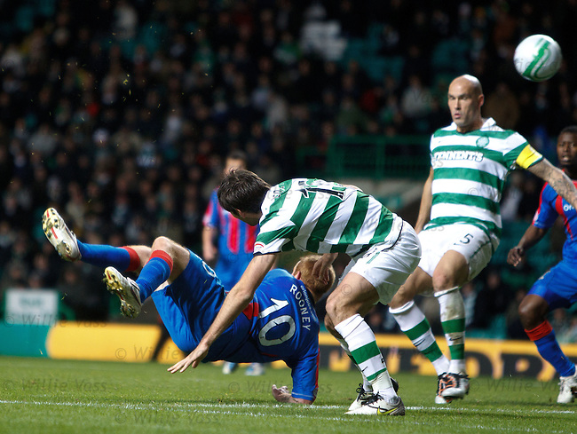 Adam Rooney scissor kicks the ball over the Celtic defenders for Grant Munro to score no 2 for Inverness