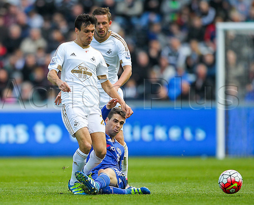 09.04.2016. Liberty Stadium, Swansea, Wales. Barclays Premier League. Swansea versus Chelsea. Swansea City's Jack Cork gets fouled by Chelsea's Oscar
