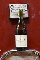 La Nine. Domaine Jean Baptiste Senat. In Trausse. Minervois. Languedoc. Painted steel vats. France. Europe. Bottle.